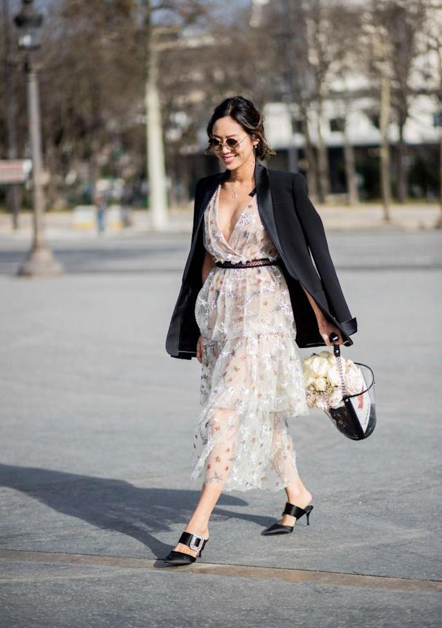 <p>Fashion influencer Aimee Song carries a transparent Chanel bucket bag while attending Paris Fashion Week. (Photo: Christian Vierig/Getty Images) </p>