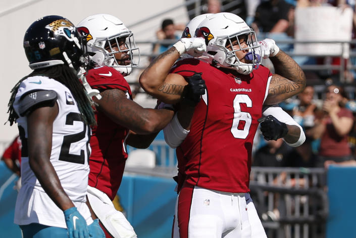 Arizona Cardinals running back James Conner (6) celebrates his 1-yard touchdown run against the Jacksonville Jaguars during the second half of an NFL football game, Sunday, Sept. 26, 2021, in Jacksonville, Fla. (AP Photo/Stephen B. Morton)