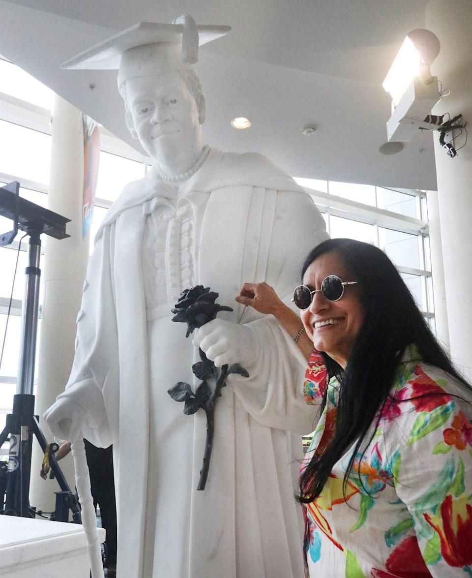 Master sculptor Nilda Comas and the statue of Dr. Mary McLeod Bethune, Wednesday October 6, 2021 as it's setup for display at the News Journal Center before going to Washington DC.