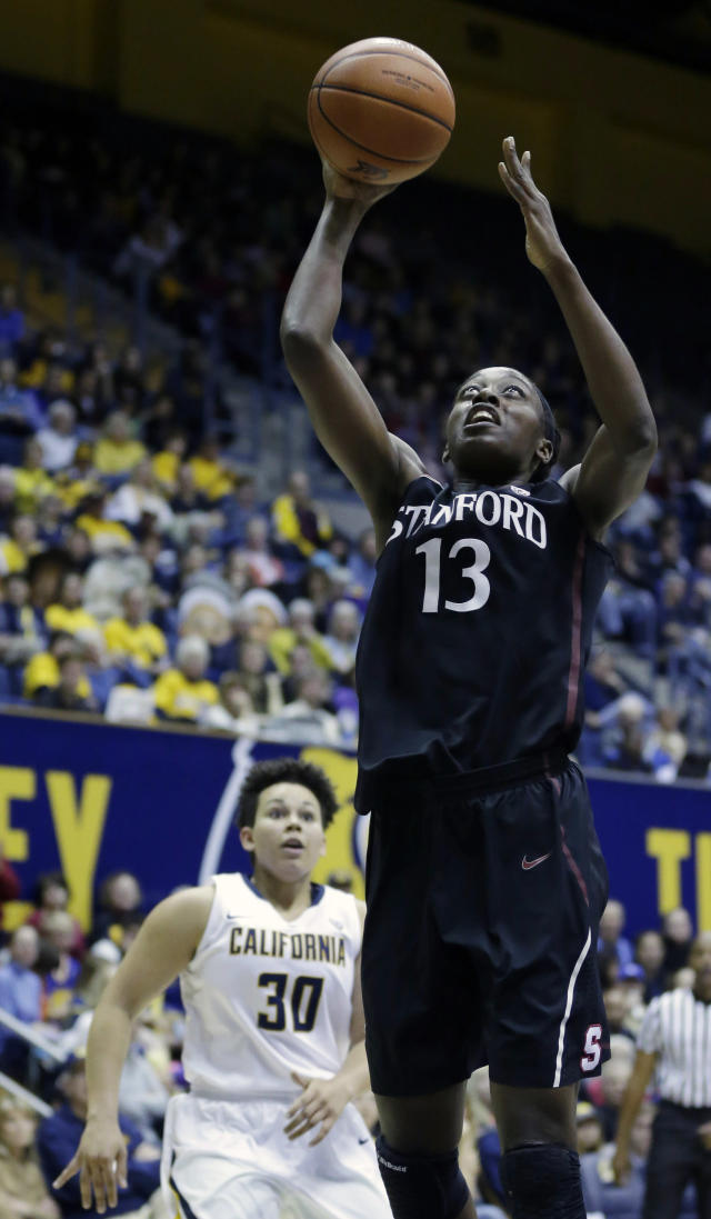 Stanford forward Chiney Ogwumike (13) scores past California guard Mikayla Lyles (30) during the first half on an NCAA college basketball game on Sunday, Feb. 2, 2014, in Berkeley, Calif. (AP Photo/Marcio Jose Sanchez)