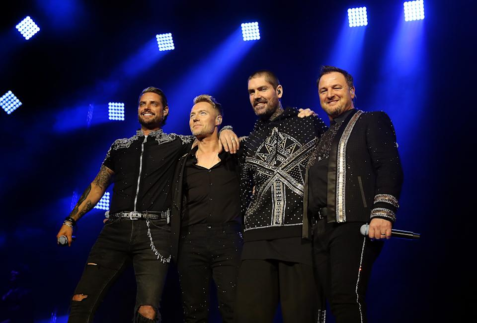 LONDON, ENGLAND - FEBRUARY 07: (EDITORIAL USE ONLY) (L-R) Keith Duffy, Ronan Keating, Shane Lynch and Mikey Graham of Boyzone perform live on stage during the 'Thank you and Goodnight Farewell Tour' at The O2 Arena on February 07, 2019 in London, England. (Photo by Simone Joyner/Getty Images)