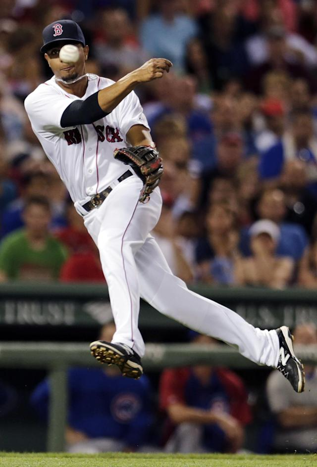 Boston Red Sox shortstop Xander Bogaerts guns down Chicago Cubs' Darwin Barney on a ground out during the seventh inning of a baseball game at Fenway Park in Boston, Monday, June 30, 2014. (AP Photo/Charles Krupa)