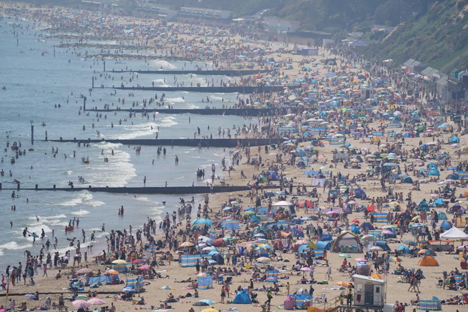 <p>Bank holiday: Brits flocked to beaches to bask in the sunshine</p> (PA Wire)
