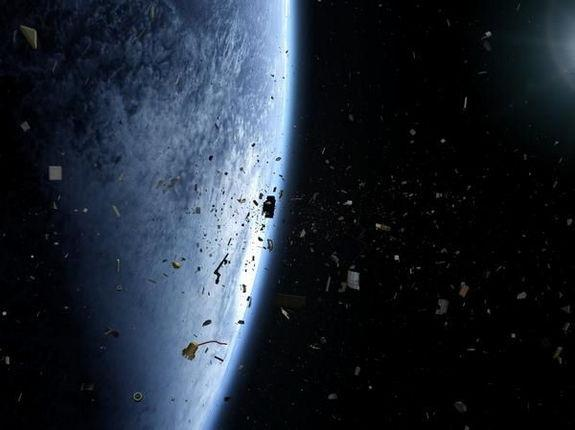 "An artist's depiction of the growing space junk problem in Earth orbit from the film ""Space Junk 3D."" The Defense Advanced Research Projects Agency has created SpaceView, a program calling for amateur astronomers to help protect American space"