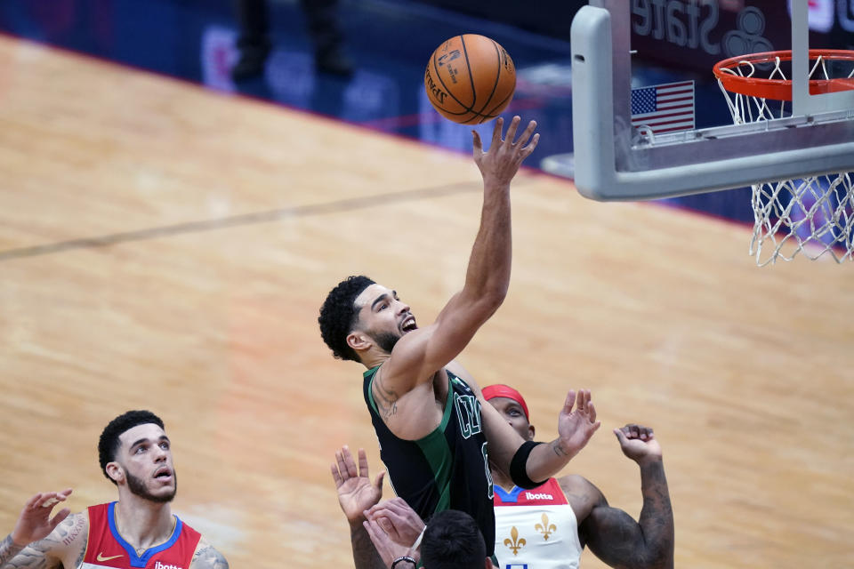 Boston Celtics forward Jayson Tatum (0) goes to the basket in the second half of an NBA basketball game against the New Orleans Pelicans in New Orleans, Sunday, Feb. 21, 2021. (AP Photo/Gerald Herbert)