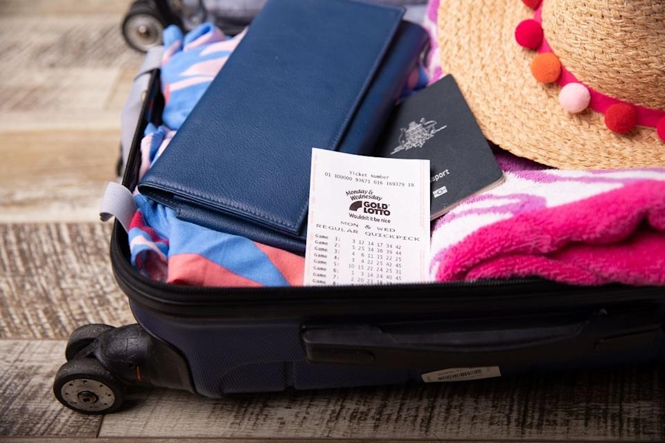 Packed suitcase with winning gold lotto ticket inside. Source: The Lott