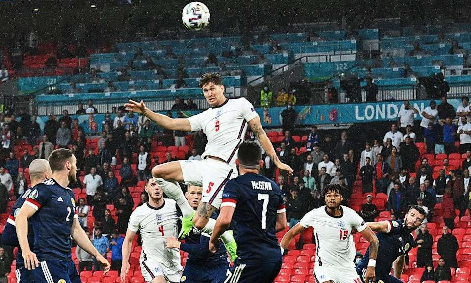 John Stones has a header from a corner – and hits a post