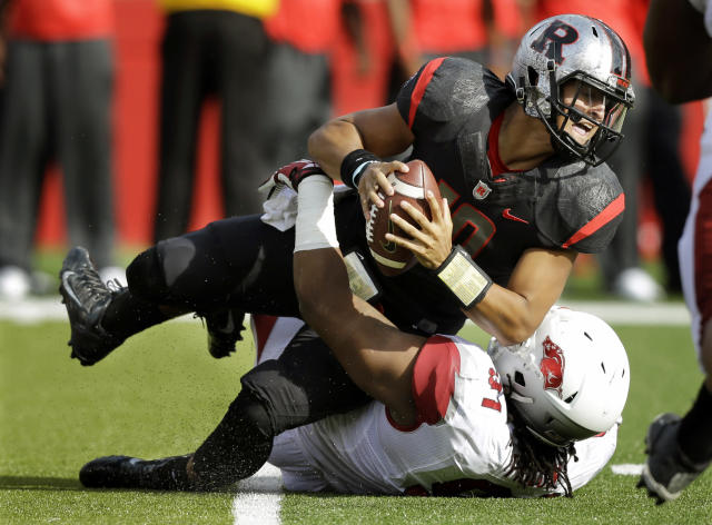 Rutgers quarterback Gary Nova, top, is sacked by Arkansas defensive tackle Darius Philon during the first half of an NCAA college football game in Piscataway, N.J., Saturday, Sept. 21, 2013. (AP Photo/Mel Evans)