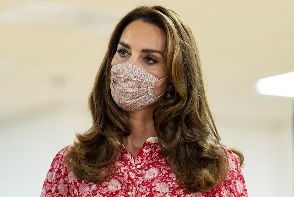 Catherine, Duchess of Cambridge wearing a floral face covering. (Photo by IAN VOGLER/POOL/AFP via Getty Images)