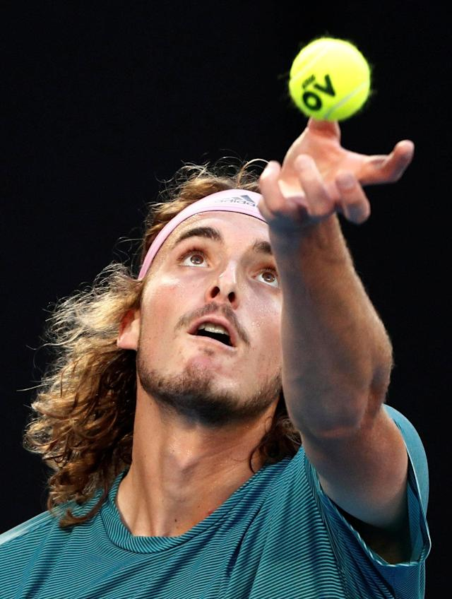 Tennis - Australian Open - Fourth Round - Melbourne Park, Melbourne, Australia, January 20, 2019. Greece's Stefanos Tsitsipas in action during the match against Switzerland's Roger Federer. REUTERS/Edgar Su TPX IMAGES OF THE DAY