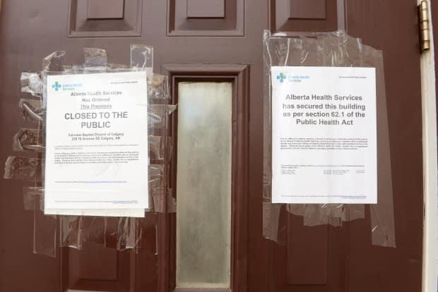 Alberta Health Services closure notices were posted to the doors of Fairview Baptist Church on Saturday.