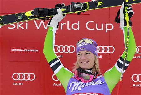 Maria Hoefl-Riesch of Germany celebrates on the podium after winning the women's FIS World Cup Downhill race in Cortina D'Ampezzo January 24, 2014. REUTERS/Alessandro Garofalo