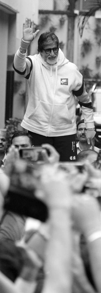 Amitabh Bachchan greeting fans outside his home.