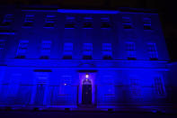 As part of the National Health Service (NHS) birthday celebrations 10 Downing Street, in London, is illuminated blue on Saturday evening, July 4, 2020. Saturday July 4, the day before the NHS birthday, has been designated as a chance for the nation to come together and pay respect. As part of this collective memorial, and as a mark of respect and tribute to NHS staff, essential workers and everyone who has played their part during the coronavirus pandemic, iconic landmarks were asked to be illuminated in blue. (Victoria Jones/PA via AP)
