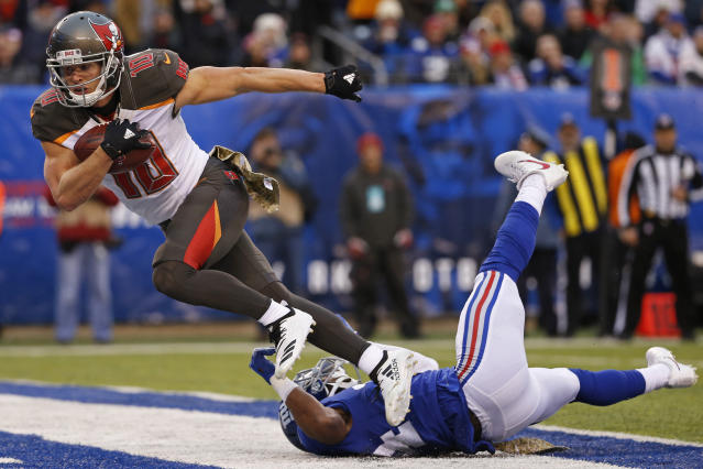 FILE - In this Nov. 18, 2018, file photo, Tampa Bay Buccaneers wide receiver Adam Humphries (10) scores a touchdown against the New York Giants during an NFL football game, in East Rutherford, N.J. For Adam Humphries, Tennessee has been a potential destination for months based on his relationship with Titans general manager Jon Robinson because of their Tampa Bay connection. Not even a late push by the New England Patriots could sway him to walk away from his deal with the Titans. Even considering how much success wide receivers like Humphries have enjoyed with the defending Super Bowl champs.Obviously, Im a man of my word, and Im going to keep my word there, Humphries said Thursday, March 14, 2019, after signing with Tennessee. (AP Photo/Adam Hunger, File)