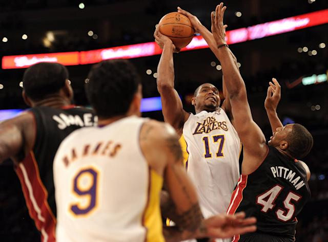 LOS ANGELES, CA - MARCH 04: Andrew Bynum #17 of the Los Angeles Lakers shoots a jumper in front of Dexter Pittman #45 of the Miami Heat at Staples Center on March 4, 2012 in Los Angeles, California. NOTE TO USER: User expressly acknowledges and agrees that, by downloading and or using this photograph, User is consenting to the terms and conditions of the Getty Images License Agreement. (Photo by Harry How/Getty Images)
