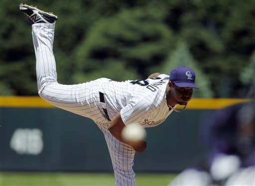 Colorado Rockies starting pitcher Juan Nicasio works to Houston Astros batter Jordan Schafer in the first inning of game one of a day/night doubleheader in Denver on Monday, May 28, 2012. (AP Photo/David Zalubowski)