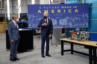"""President Joe Biden speaks with William """"Bill"""" Ford, Jr., Executive Chairman, Ford Motor Company, left, as he tours the Ford Rouge EV Center, Tuesday, May 18, 2021, in Dearborn, Mich. (AP Photo/Evan Vucci)"""