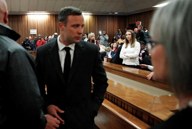 Sister Aimee Pistorius looks on as Olympic and Paralympic track star Oscar Pistorius leaves the court after his sentence hearing at the North Gauteng High Court in Pretoria, South Africa, July 6, 2016. REUTERS/Marco Longari/Pool
