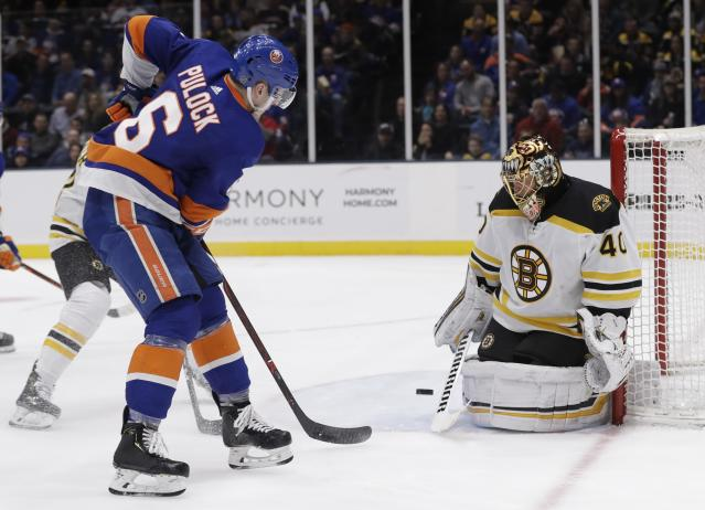 Boston Bruins goaltender Tuukka Rask (40) stops a shot on the goal by New York Islanders' Ryan Pulock (6) during the second period of an NHL hockey game Tuesday, March 19, 2019, in Uniondale, N.Y. (AP Photo/Frank Franklin II)