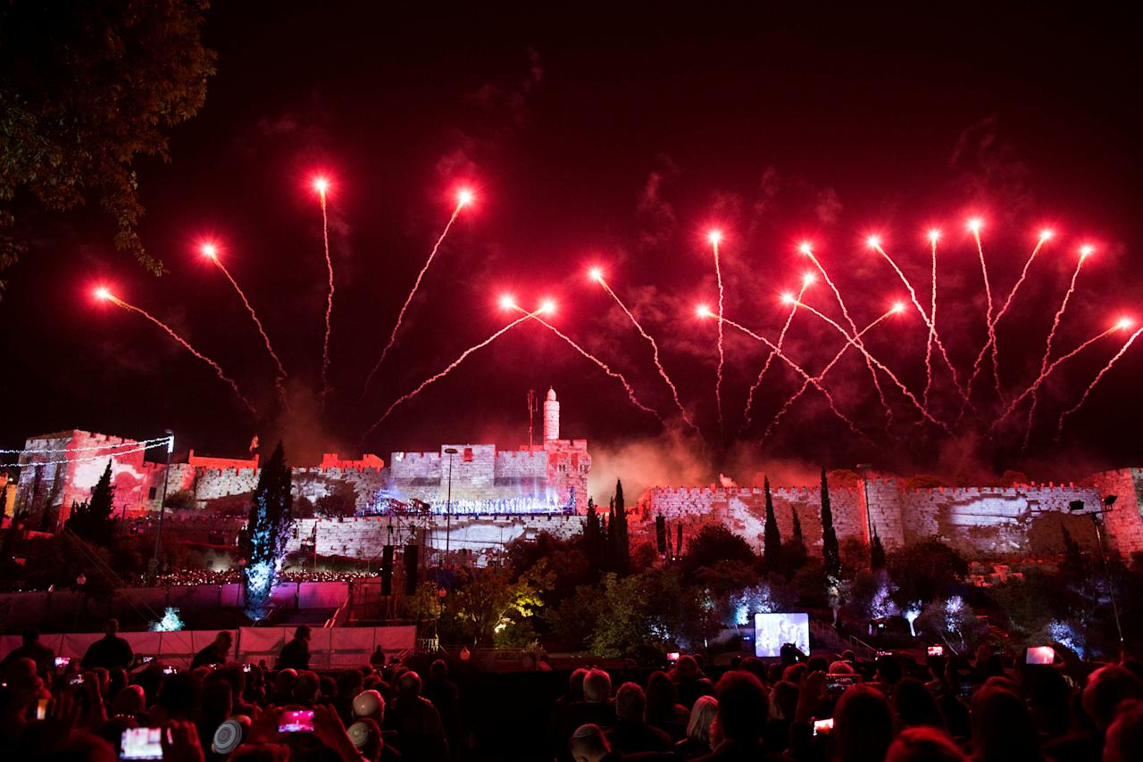 Fireworks are seen over the walls of the Jerusalem Old City during an event marking the 50th anniversary of Israel's capture of East Jerusalem during the 1967 Six-Day War, opposite the Old City wall and near the Tower of David in Jerusalem May 21, 2017. REUTERS/Abir Sultan/Pool