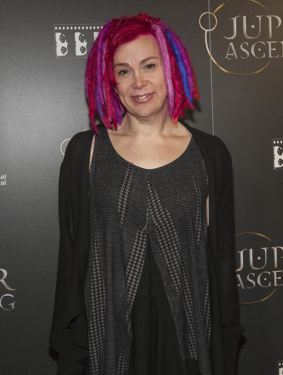 "FILE - In this Feb. 4, 2014 file photo, Lana Wachowski attends the Chicago International Film Festival's screening of ""Jupiter Ascending"" at the AMC River East theater, in Chicago. Keanu Reeves and Wachowski are returning to the world of ""The Matrix."" Warner Bros. Pictures Group chairman Toby Emmerich says Tuesday, Aug. 20, 2019, that a fourth ""Matrix"" is in the works. (Photo by Barry Brecheisen/Invision/AP, File)"