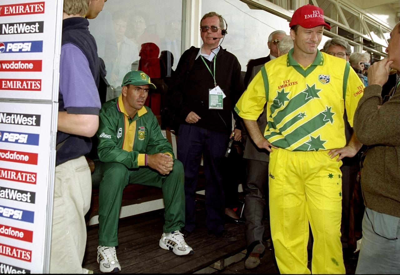 17 Jun 1999:  Contrasting emotions for the two captains Hansie Cronje of South Africa and Steve Waugh of Australia after the World Cup semi-final at Edgbaston in Birmingham, England. The match finished a tie as Australia went through after finishing higher in the Super Six table. \ Mandatory Credit: Ross Kinnaird /Allsport