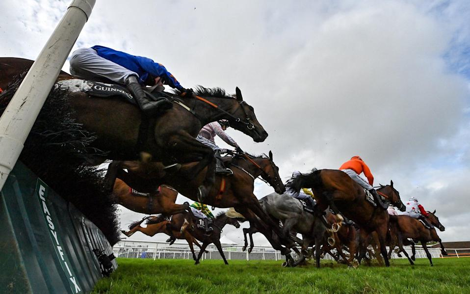 A general view of the runners and riders as they jump the seventh during the Guinness Galway Tribes Handicap Hurdle - Sportsfile