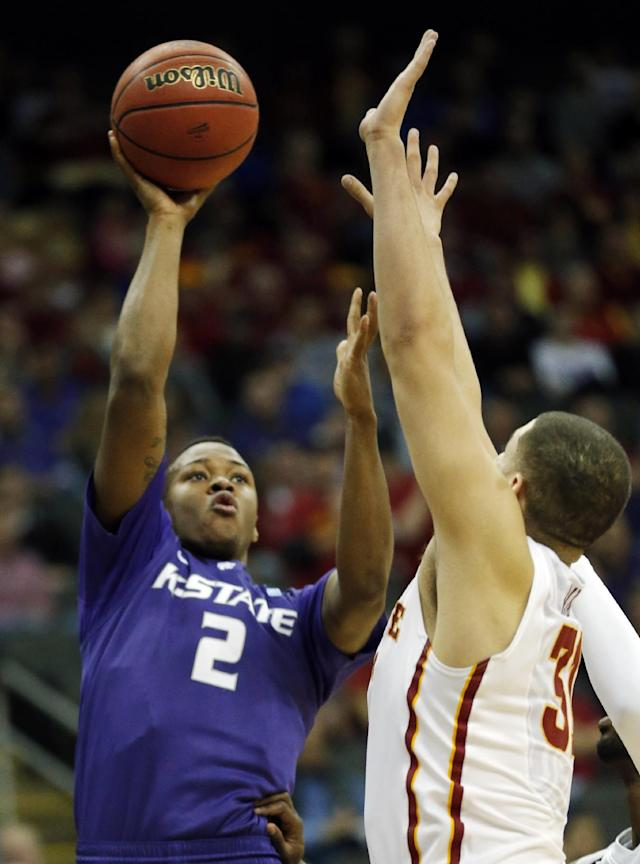 Kansas State guard Marcus Foster (2) shoots over Iowa State forward Georges Niang during the first half of an NCAA college basketball game in the quarterfinals of the Big 12 Conference tournament in Kansas City, Mo., Thursday, March 13, 2014. (AP Photo/Orlin Wagner)