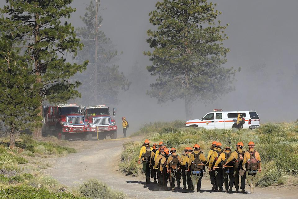 Firefighters in California battle wildfires (AP)