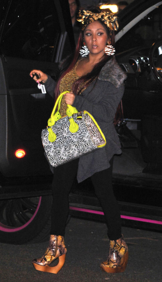 Snooki is spotted in a pair of funky wooden snakeskin platforms in Jersey City on February 26, 2012.