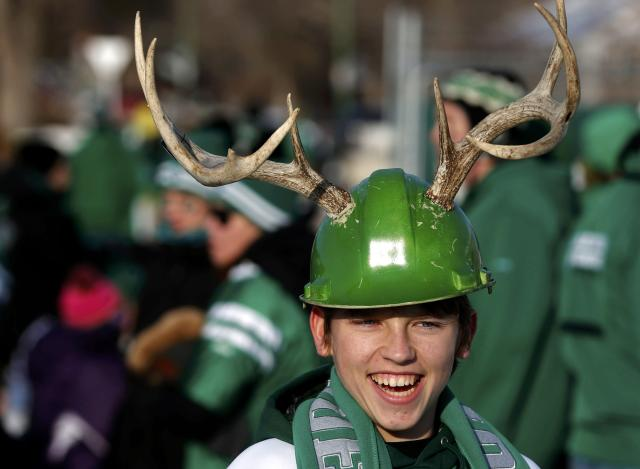 Fan Alexei Bashutsky sports antlers on his helmet prior to 101st Grey Cup game championship football game in Regina, Saskatchewan November 24, 2013. REUTERS/Todd Korol (CANADA - Tags: SPORT FOOTBALL)