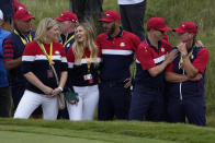Team USA captain Steve Stricker is congratulated by assistant captain Zack Johnson after the Ryder Cup matches at the Whistling Straits Golf Course Sunday, Sept. 26, 2021, in Sheboygan, Wis. (AP Photo/Jeff Roberson)