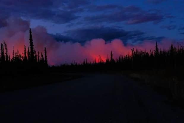 Smoke from a wildfire near Stewart Crossing, Yukon, in 2019. Many parts of central Yukon are under a moderate to extreme fire danger rating heading into the weekend. (Submitted by Claus Vogel - image credit)