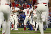 St. Louis Cardinals' Yadier Molina, second from left, is held back by teammate Matt Carpenter during a bench-clearing argument after Molina was hit by a pitch during the second inning of a baseball game against the Chicago Cubs, Saturday, Sept. 28, 2019, in St. Louis. (AP Photo/Scott Kane)