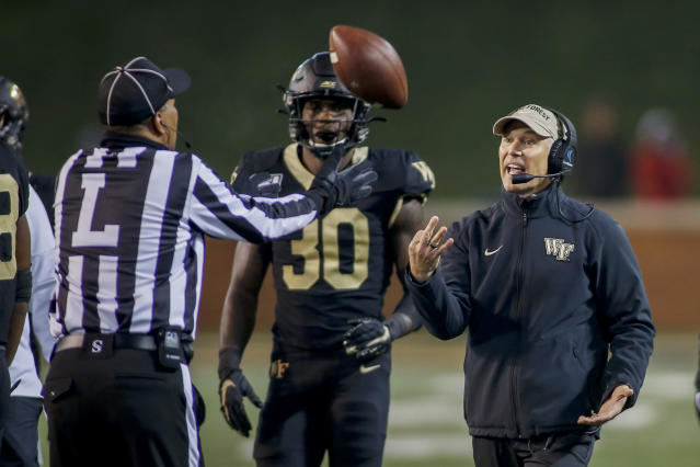 Wake Forest head coach Dave Clawson, right, argues with line judge Tim Graham as Wake Forest linebacker Ja'Cquez Williams (30) looks on in the second half of an NCAA college football game against Duke in Winston-Salem, N.C., Saturday, Nov. 23, 2019. Wake Forest won 39-27. (AP Photo/Nell Redmond)