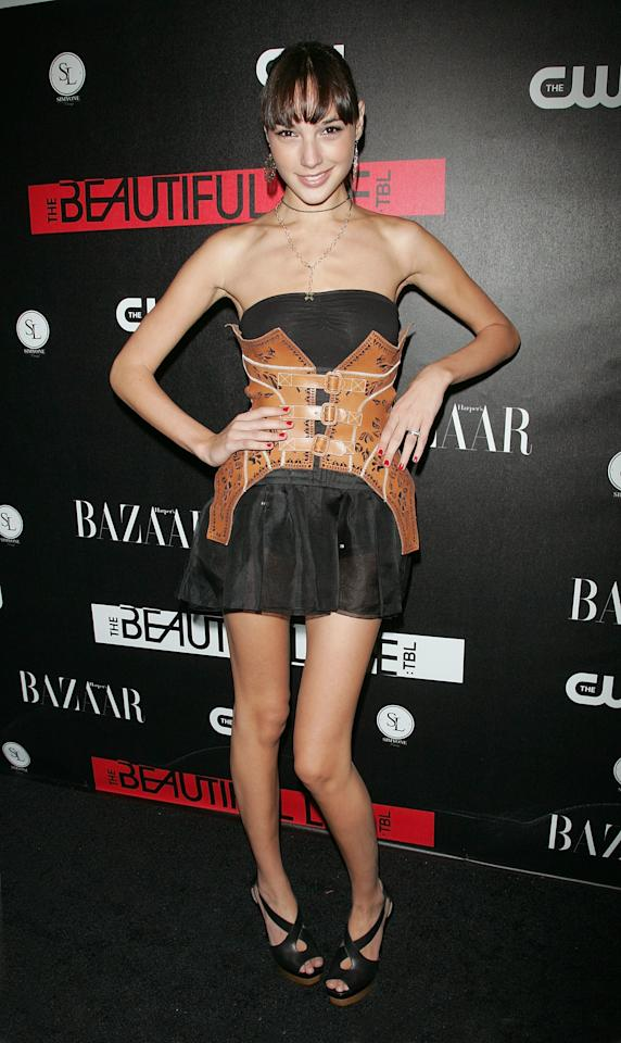 """<p><b>MORE: <a rel=""""nofollow"""" href=""""http://www.wmagazine.com/gallery/gal-gadot-beauty-evolution?mbid=synd_yahoolife"""">Gal Gadot's Best Beauty Moments, From Fast & Furious to Wonder Woman</a></b></p><p>The young actress first arrived on the scene at the CW Network celebration of its new series <em>The Beautiful Life: TBL</em> dressed in flirty strapless little black dress paired with an oversized tan corset belt. She completed her look with a pair of black cross-strap platform sandals.</p>"""