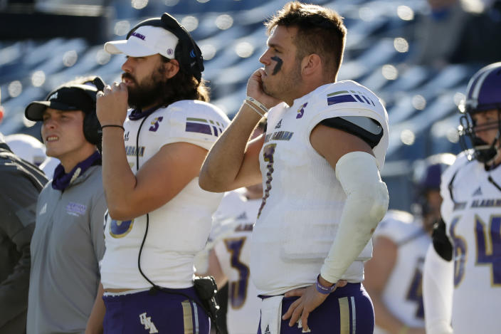 North Alabama quarterback Blake Dever (7) stands on the sideline after being pulled from the game in the second quarter of an NCAA college football game against BYU, Saturday, Nov. 21, 2020, in Provo, Utah. (AP Photo/Jeff Swinger, Pool)