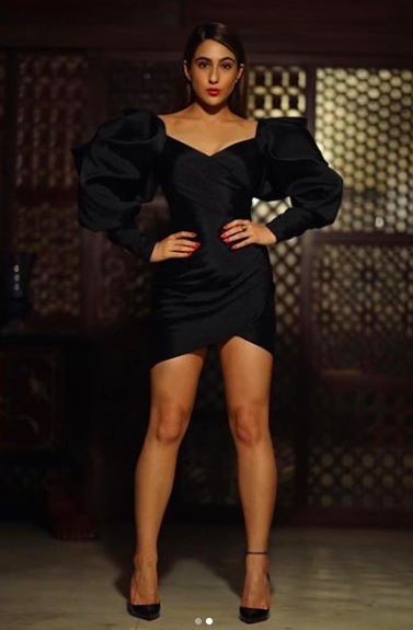Sara looked fierce in an elevated version of the LBD (little black dress) by Monisha Jaising. The exaggerated sleeves, sleek hair, high heels and a pop of dark red lips made her look like a woman in power.