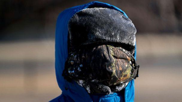 PHOTO: A boy has his face bundled against temperatures in the teens on the National Mall, Dec. 28, 2017, in Washington.  (Andrew Harnik/AP)