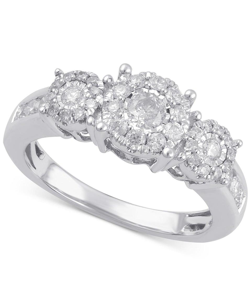 <p>All focus will be on the diamonds in this <span>Diamond Three Stone Engagement Ring</span> ($2,250).</p>