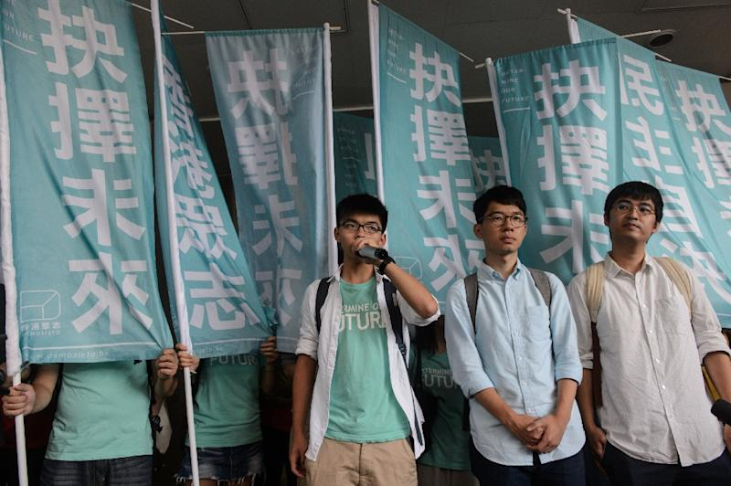 Student leaders (L to R) Joshua Wong, Nathan Law and Alex Chow were convicted for a protest that sparked major pro-democracy rallies in Hong Kong (AFP Photo/Anthony Wallace)