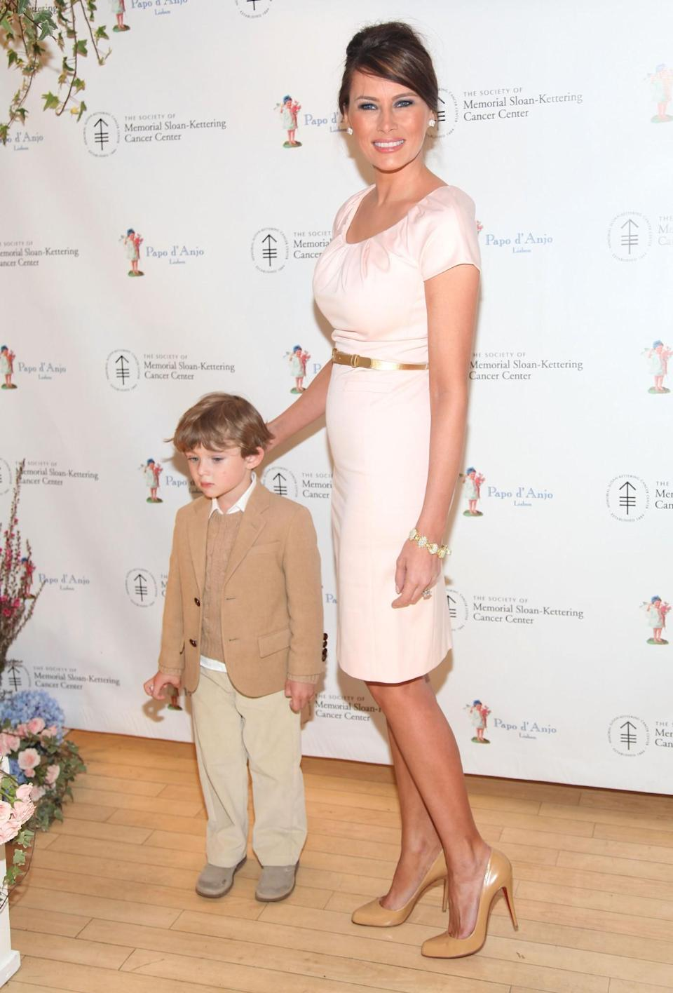 <p>Melania took her son to a charity event dressed in a feminine fitted dress and nude courts. <i>[Photo: Getty]</i> </p>