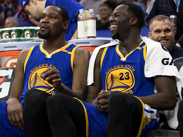 Kevin Durant and Draymond Green on the Golden State Warriors bench.