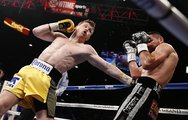 Saul Alvarez, left, of Mexico, trades punches with Alfredo Angulo, of Mexico, during their super welterweight boxing match, Saturday, March 8, 2014, in Las Vegas. (AP Photo/Eric Jamison)