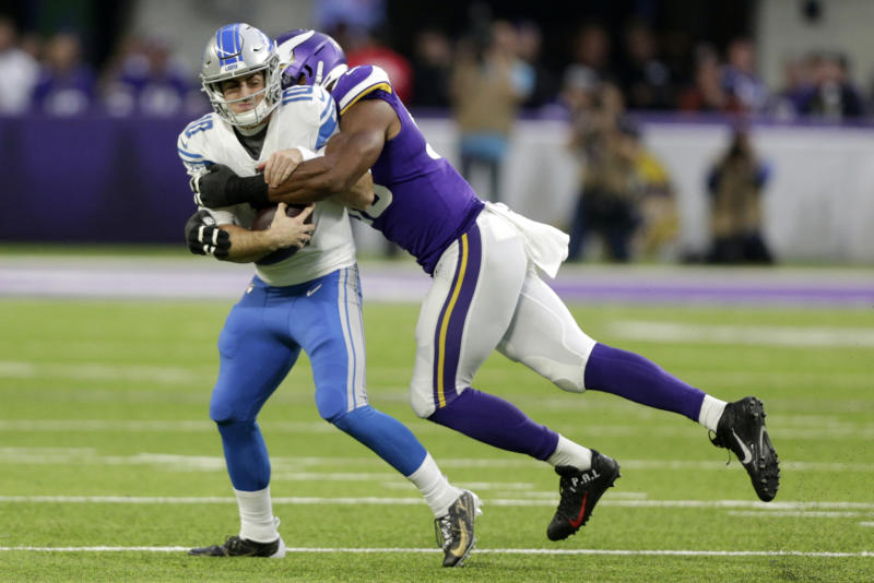 Detroit Lions quarterback David Blough is sacked by Minnesota Vikings defensive end Danielle Hunter, right, during the first half of an NFL football game, Sunday, Dec. 8, 2019, in Minneapolis. (AP Photo/Andy Clayton-King)