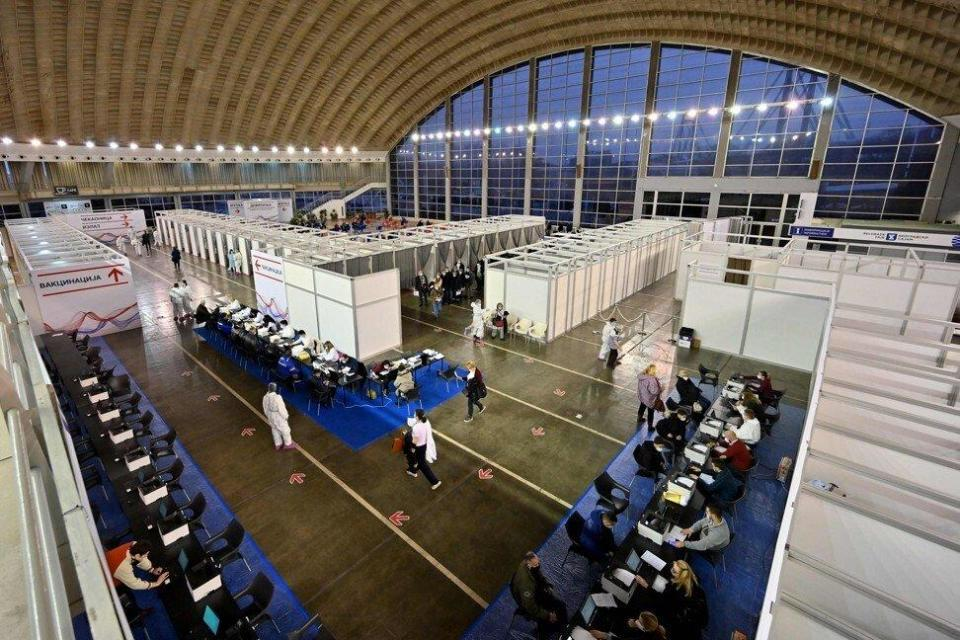 Serbians arrive to receive the Sinopharm vaccine at Belgrade Fair, which was turned into a vaccination centre. Sports stadiums, cathedrals and theme parks around the world have been repurposed as temporary vaccination centres. Photo: AFP