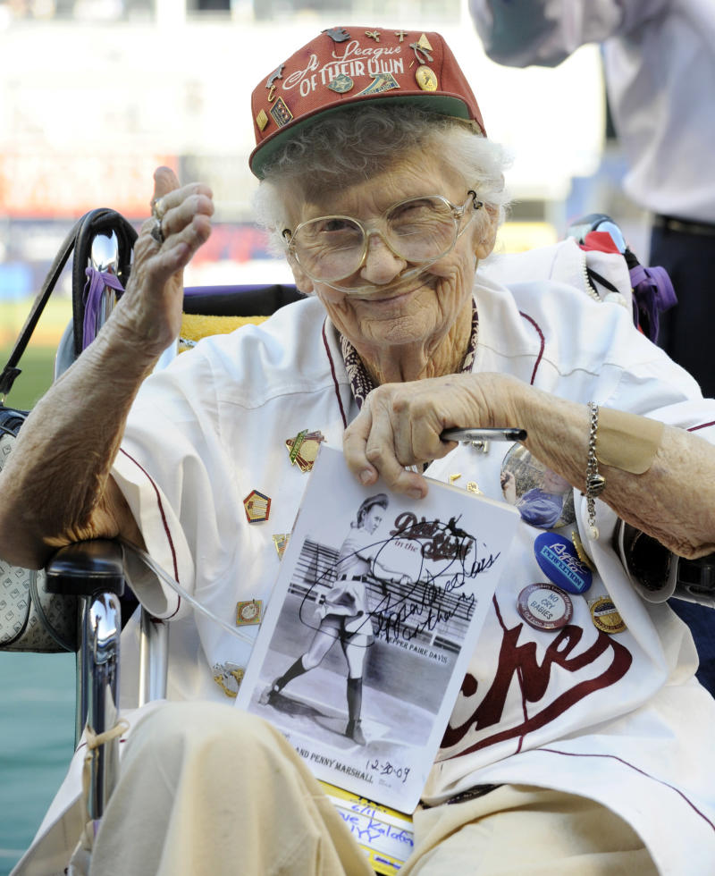 """FILE - Lavonne """"Pepper"""" Paire-Davis,  seen here in a file photo taken  June 11, 2010, at Yankee Stadium in New York, watches the Houston Astros warm up before playing the New York Yankees. Davis, a star of the All American Girls Professional Baseball League in the 1940s and an inspiration for the movie """"A League of Their Own,"""" has died in Southern California. She was 88. (AP Photo/Bill Kostroun, File)"""