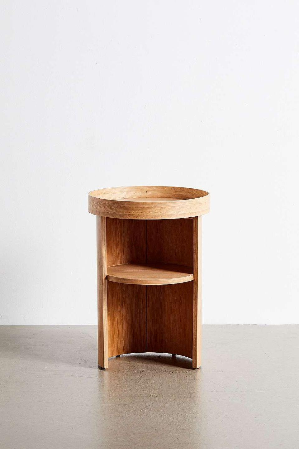 """<p>The lower shelf of this well-proportioned side table is a practical second surface for books, alarm clocks et al, while the tray-style top and enclosed sides grant a sense of order and visual calm. It will slot into the corner of a living room as happily as beside a bed. £99, <a href=""""https://go.redirectingat.com?id=127X1599956&url=https%3A%2F%2Fwww.urbanoutfitters.com%2F&sref=https%3A%2F%2Felledecoration.co.uk%2Fdesign%2Fg37395542%2Fside-table%2F"""" rel=""""nofollow noopener"""" target=""""_blank"""" data-ylk=""""slk:urbanoutfitters.com"""" class=""""link rapid-noclick-resp"""">urbanoutfitters.com</a></p>"""