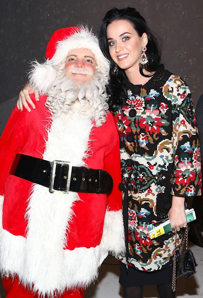 "NEW YORK, NY - DECEMBER 12:  Katy Perry (R) poses for photos with Santa from  ""A Christmas Story, The Musical"" Broadway Performance at Lunt-Fontanne Theatre on December 12, 2012 in New York City.  (Photo by Astrid Stawiarz/Getty Images)"
